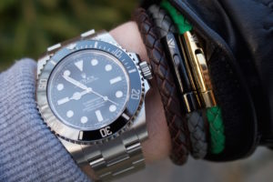 Leather bracelets and rolex watch